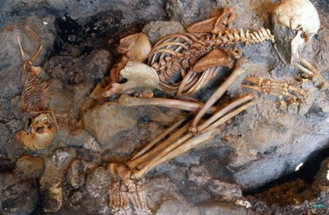 Remains of a child and a young adult male excavated from the ash surge deposits at Herculaneum.